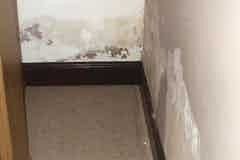 Example image of wallpaper peeling due to rising damp