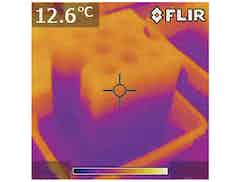 Thermal image of concrete block resting in water. Lower part of image is cooler as rising damp has led to evaporative cooling