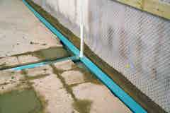 Aquadrain installed at the floor-wall junction