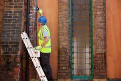 Applying Stormdry around the windows of the church