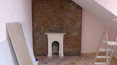 Hygroscopic salt damage can be seen on the chimney breast