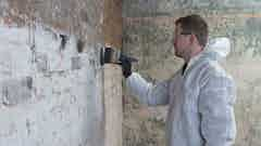 Applying Dryshield Cream to the wall