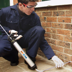 Injection of Dryzone Damp-Proofing Cream into a damp wall