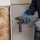 Drill holes 25 mm from corners of plasterboard