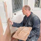 Plaster over the plasterboard with a skim coat