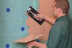 Applying plaster on top of Oldroyd Xp Plaster Membrane