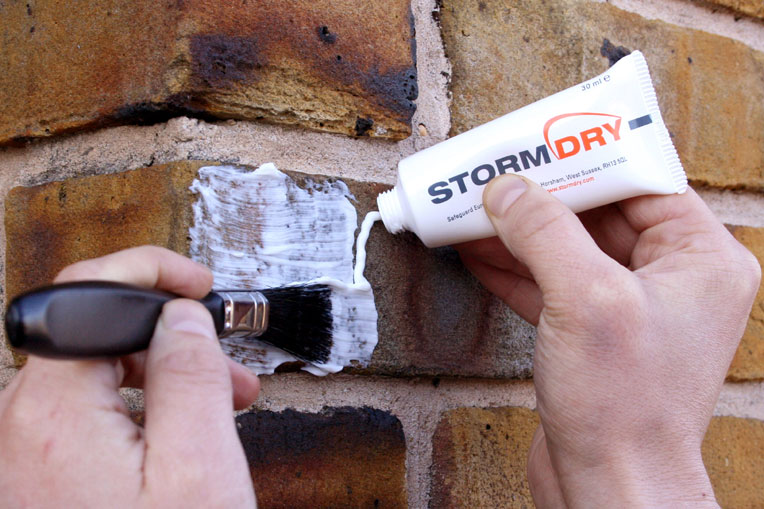 Application of test patch of Stormdry Masonry Protection Cream