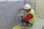 Dryzone Damp-Resistant Plaster being applied to a wall for flood resilience purposes