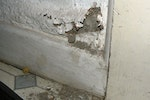 Example image of paint blistering caused by rising damp