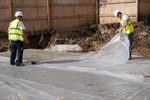 Polythene sheet laid on top of Vandex Super to increase curing time