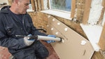 Applying Drygrip Adhesive to the back of the plasterboard