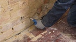 Installing Dryrod Damp-Proofing Rods into the base of the wall to form a damp-proof course