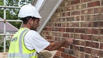 Repointing the brickwork with Stormdry Repointing Additive