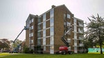 Applying Stormdry Masonry Protection Cream to the buildings using cherry pickers