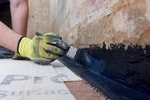 The new plaster will be protected by Drybase Liquid-Applied DPM at the floor-wall junction