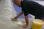 Laying of floor tiles