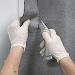 Remove excess adhesive and trim the excess membrane