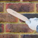 Remove surface laitance with a masonry brush