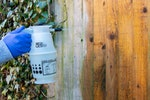 Roxil 100 Wood & Patio Cleaner being spray applied to a wooden fence panel